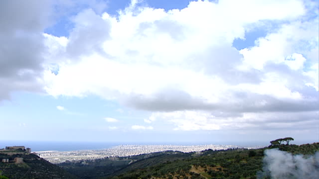 high-angle view from the hills of ain anoub of the beirut peninsula jutting out into the mediterranean sea on a cloudy day. - peninsula stock videos & royalty-free footage