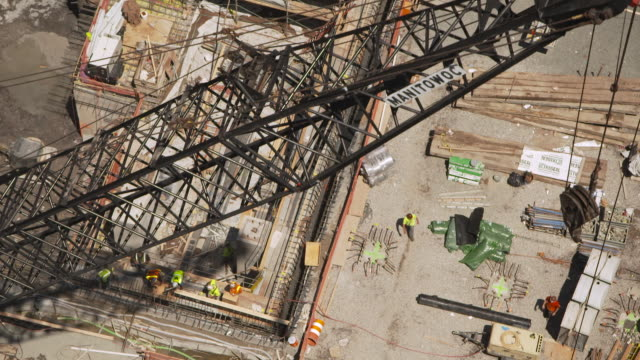 high-angle view of a crane moving across part of the construction site for the new world trade center buildings during the summer of 2011, manhattan, new york city, usa. - september 11 2001 attacks stock videos & royalty-free footage