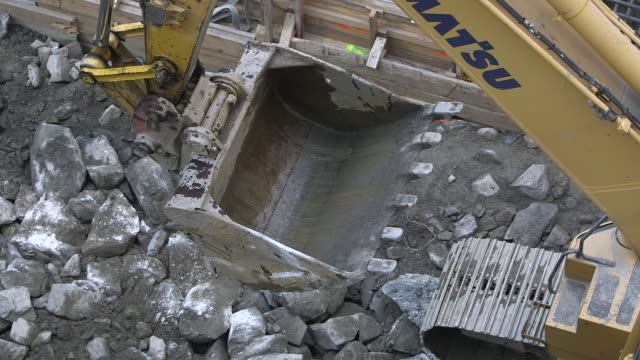 highangle view of a digger in motion on a building site in manhattan new york usa fkax911w clip taken from programme rushes abma938f - schist stock videos and b-roll footage