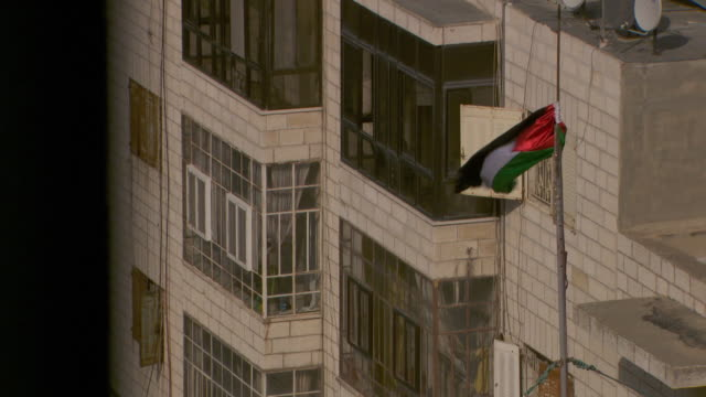 Highangle view of a Palestinian flag on an elevated flagpole in Ramallah in the West Bank