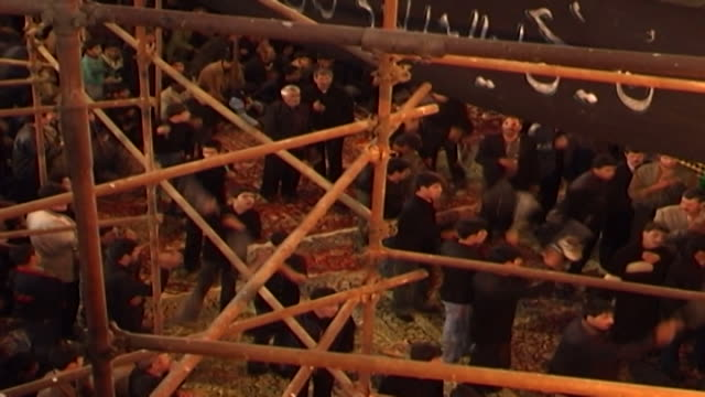 highangle view of boys whipping themselves as part of ashura azadari rituals at a mosque in isfahan province ashura the tenth day of the islamic... - ashura muharram stock videos & royalty-free footage
