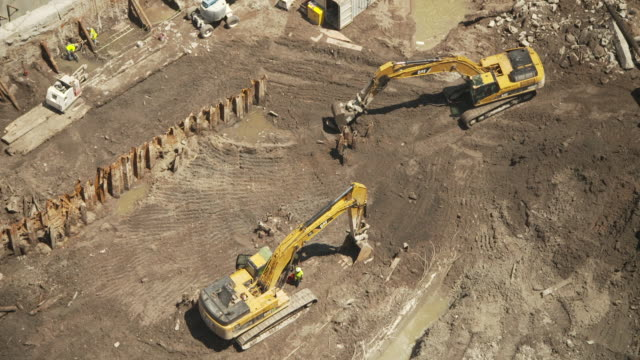 high-angle view of builders using diggers during construction of one of the new world trade center buildings, september 2011, manhattan, new york city, usa. - september 11 2001 attacks stock videos & royalty-free footage