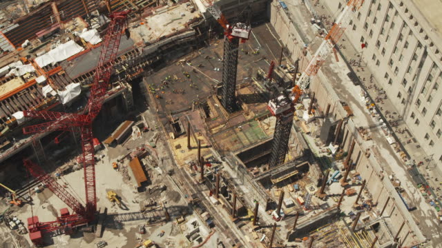 High-angle view of cranes at the edge of the construction site for part of the new World Trade Center in Manhattan, New York City, USA, summer 2011.