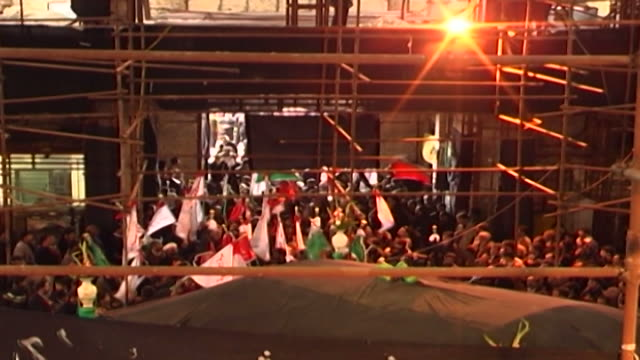 highangle view of men waving flags during ashura at a mosque in isfahan province ashura the tenth day of the islamic month of muharram commemorates... - ashura muharram stock videos & royalty-free footage
