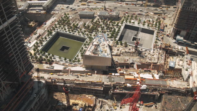 high-angle view of reflecting absence, the national september 11 memorial, whilst under construction in 2011, usa. - rebuilding stock videos & royalty-free footage