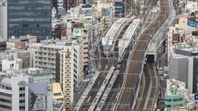 4k t/l ha td high-angle view of subway trains station winding pass each other at tokyo, japan - elevated train stock videos & royalty-free footage