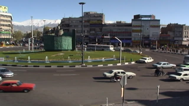 high-angle view of traffic around enghelab square. there is an islamic revolution monument to ayatollah khomeini and sayyed mohammad husseini... - revolution stock videos & royalty-free footage