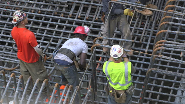 highangle view of workers fixing rebar whilst laying foundations for a new building in manhattan new york city usa fkax911w clip taken from programme... - stange stock-videos und b-roll-filmmaterial
