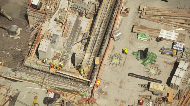 high-angle view showing builders at work on the site of one of the new world trade center buildings in the summer of 2011, manhattan, new york city, usa. - september 11 2001 attacks stock videos & royalty-free footage