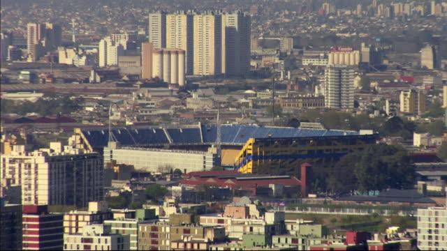 ws zo high-angle view south across puerto madera canal features estadio alberto j. armando / buenos aires,  argentina - ラボカ点の映像素材/bロール