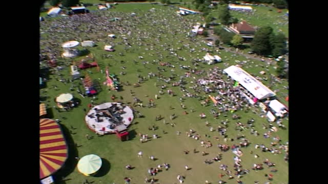 high-angle, wide shots moving upwards to reveal people gathering in preston park as part of pride in brighton. this footage was taken from a platform... - construction machinery stock videos & royalty-free footage
