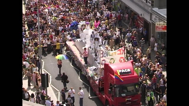 high-angle wide shots showing busy scenes at pride in brighton as people take part in the parade, uk; 2000. - commercial land vehicle stock videos & royalty-free footage