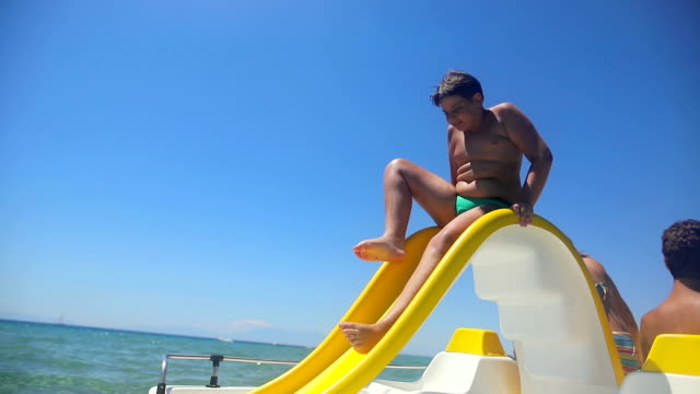 highboard diving.fun on the toboggan in the summer - pedal boat stock videos and b-roll footage
