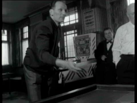 highbury henry cooper walking along street cooper inside pub playing billiards with manager jim wicks cooper training hitting boxing speed bag henry... - 50 sekunden oder länger stock-videos und b-roll-filmmaterial