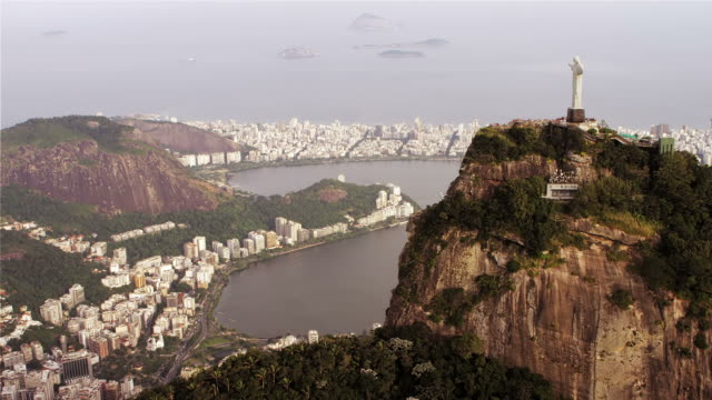 stockvideo's en b-roll-footage met high-definition aerial shot of christ the redeemer and corcovado. - international landmark