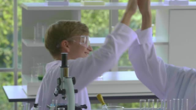high-five : funny lab - professor stock videos & royalty-free footage