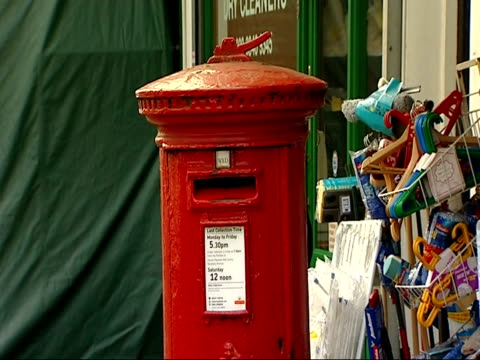 highgate post office proposed closure; england: london: highgate: ext highgate village post office / post box outside post office / woman posts... - highgate stock videos & royalty-free footage