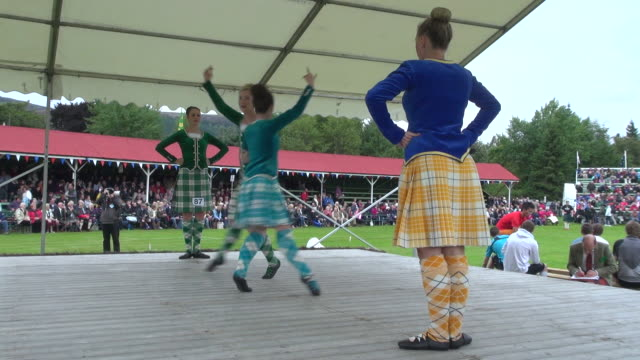 ms highland dancer performing at braemar royal highland games / braemar, aberdeenshire, scotland - scottish culture stock videos & royalty-free footage