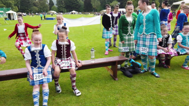 vidéos et rushes de highland dancers take part in the inveraray highland games on july 16, 2019 in inverarary, scotland.the games celebrate scottish culture and heritage... - scottish culture