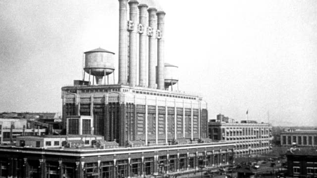 highland park ford plant exterior showing smokestacks in highland park michigan 1916 - schornstein konstruktion stock-videos und b-roll-filmmaterial