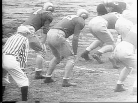 highlights from the game / close-up of cadet with fingers crossed / notre dame scores another touchdown in fourth quarter / notre dame wins 26-0 /... - 1943 stock-videos und b-roll-filmmaterial
