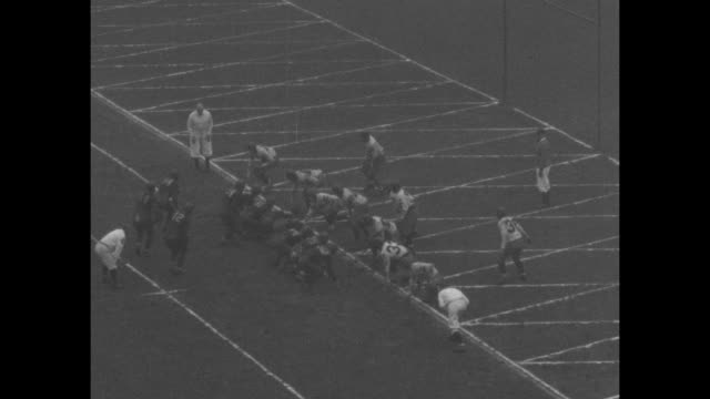 [highlights of 1929 season various games] three shots of huge crowd in soldier field in chicago for games between fighting irish of notre dame... - 1929 stock videos & royalty-free footage
