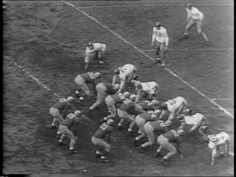 highlights of the second half of the navy vs notre dame football game / crowd cheering in the stands / navy throws a touchdown / notre dame... - 1943 stock-videos und b-roll-filmmaterial