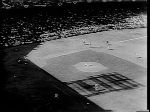 Highlights of World Series games / Cardinals fans crowd the stands at Sportsman's Park St Louis / a plane passes overhead / fans cheer in the stands...