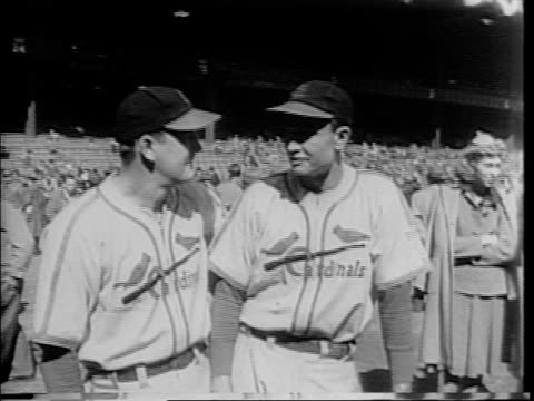 highlights of world series games / the cardinals' cooper brothers morton cooper and william walker cooper stand side by side / close up of ernest e... - home run stock-videos und b-roll-filmmaterial