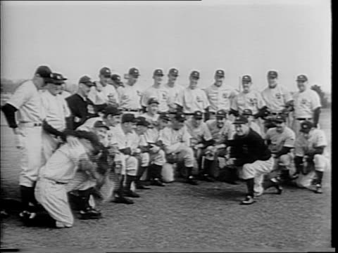 highlights of world series games / 'yanks win series' superimposed / baseball commissioner kenesaw mountain landis / players swinging bats / close up... - mountain pose stock videos and b-roll footage