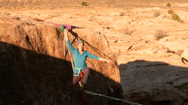 highlining in moab, utah - courage stock videos & royalty-free footage