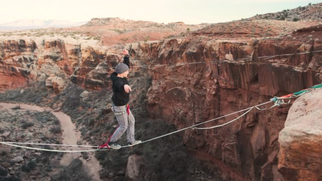 highlining in moab, utah - extreme sports stock videos & royalty-free footage
