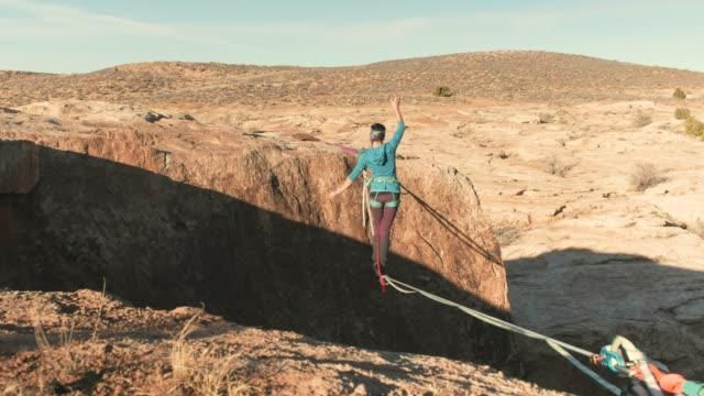 highlining in moab, utah - canyon stock videos & royalty-free footage