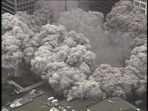 high-rise building implodes in clouds of dust during its demolition. - demolished stock videos & royalty-free footage
