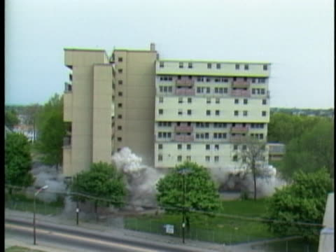 high-rise building resists demolition, still standing after explosions set to bring it down. - office block exterior stock videos & royalty-free footage