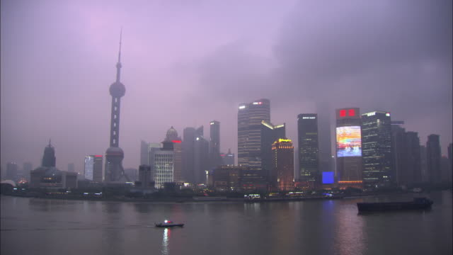 ws high-rise buildings at dusk, shanghai - the bund stock videos & royalty-free footage