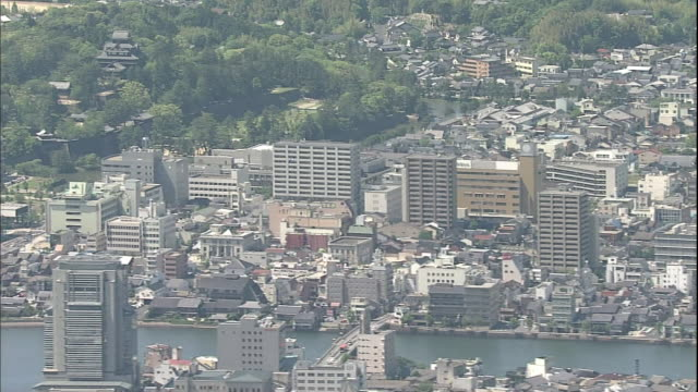 high-rise buildings line the ohashi river in matsue city, japan. - shimane prefecture stock videos & royalty-free footage