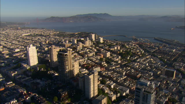 aerial high-rise buildings on russian hill and marina district, golden gate bridge in distance, california, usa - north beach san francisco stock videos & royalty-free footage