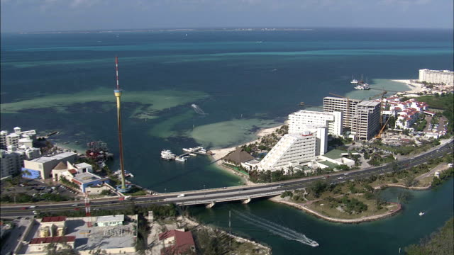 high-rise hotels in cancun overlook the ocean. - cancun stock videos & royalty-free footage