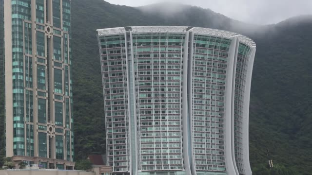 Highrise luxury residential properties at Repulse Bay beach in Hong Kong PAN RL beach and apartment properties behind PAN RL beach and apartment...