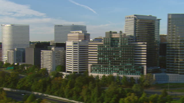 ws pan high-rise offices along potomac river, rosslyn, virginia, usa - arlington virginia stock videos and b-roll footage