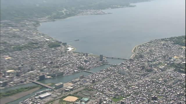 high-rises and city neighborhoods surround lake shinji in matsue city, japan. - shimane prefecture stock videos & royalty-free footage