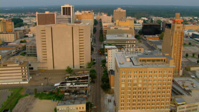 high-rises and office buildings flank either side of a jackson, mississippi street. - jackson stock videos & royalty-free footage