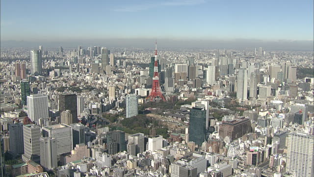 Highrises and skyscrapers surround the Tokyo Tower in Tokyo, Japan.