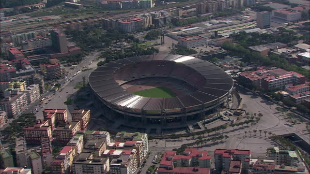 high-rises surround an empty san paolo stadium outside of naples, italy. - ナポリ点の映像素材/bロール