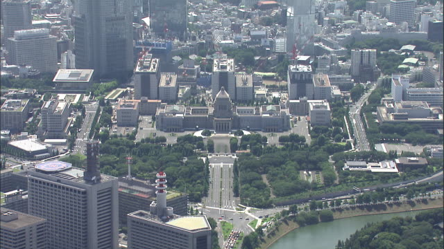 highrises surround the diet building in a cityscape aerial of tokyo, japan. - 国会議事堂点の映像素材/bロール