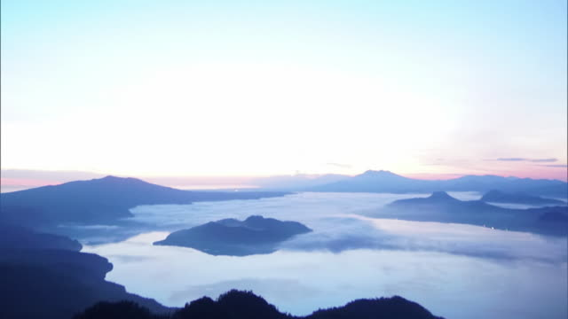 high-sensitivity camera shot at nighttime; looking down from starry sky to get a long shot of the sea of clouds over lake kussharo - stratus stock videos & royalty-free footage