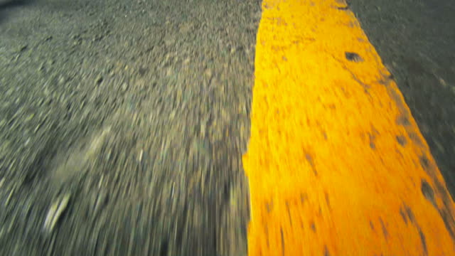 high-speed pov of a road - yellow stock videos & royalty-free footage
