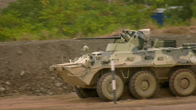 high-speed driving of an armored vehicle - machine gun stock videos & royalty-free footage