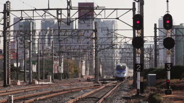 LS, R/F KTX high-speed train approaching Seoul Station / Seoul, South Korea
